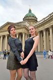 Friend of the student standing in front of the Kazan Cathedral royalty free stock photography