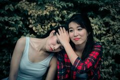 Friend support young depressed girl. Woman embracing upset friend. stock images