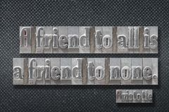 Friend to none Aristotle. A friend to all is a friend to none - ancient Greek philosopher Aristotle quote made from metallic letterpress on dark background royalty free stock image