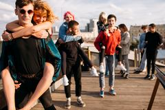 Friend unity dream freedom fun young diverse. Friends unity dreams freedom concept. Young group of diverse friends laugh bonding and have fun Stock Images