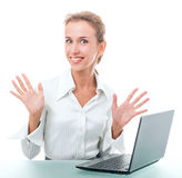 Friendly administrative assistant at the desk with a laptop. Young woman in office attire. The figure is isolated on a white background with the clipping path Stock Images