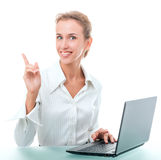 Friendly administrative assistant with laptop. Young woman in office attire. The figure is isolated on a white background with the clipping path Stock Images