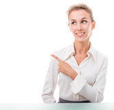 Friendly administrative assistant making hand gestures Royalty Free Stock Images