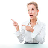 Friendly administrative assistant making hand gestures. Young woman in office attire. The figure is isolated on a white background with the clipping path Royalty Free Stock Photos
