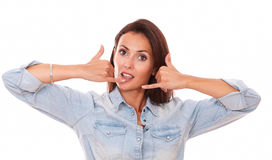 Friendly adult brunette with phone gesture Stock Photo