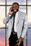 Friendly afro man with cellphone. Royalty Free Stock Photo