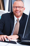 Friendly Ambitious Businessman smiling  in office Royalty Free Stock Photo