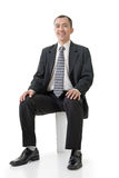 Friendly Asian business man sit Stock Photos