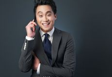 Friendly Asian Businessman on Phone Stock Photo