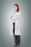 Friendly Asian doctor. Woman, full length portrait isolated Stock Photos