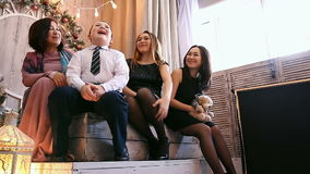 Friendly Asian family. Mom, daughter, younger brother. Christmas stock video