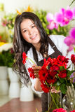 Chinese Saleswoman in a flower shop Stock Photo