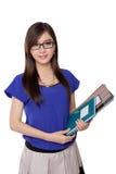 Friendly Asian teacher holding books, isolated on white Stock Photos