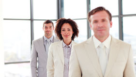 Friendly attractive businesswoman in a line Stock Images