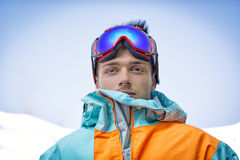 Friendly attractive skier or snowboarder against blue sky Stock Photo