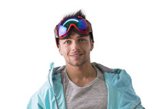 Friendly attractive young male skier or snowboarder. Isolated on white smiling Royalty Free Stock Images
