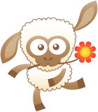 Friendly baby sheep dancing animatedly while holding a flower with its mouth Royalty Free Stock Images