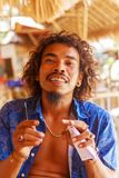 Friendly bartender-Rastaman in the beach bar on the beaches of I Stock Images