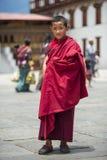 Friendly Bhutanese young Buddhism monk in Dzong , Thimphu , Bhutan royalty free stock image