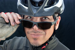 Friendly Bicycle Courier Looks Over Sunglasses Stock Photography