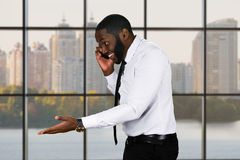 Friendly black guy with cellphone. Stock Photos