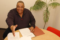 friendly black man in office stock photography
