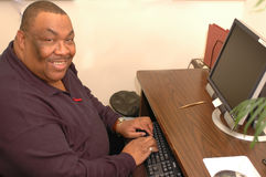 Friendly black man in office Stock Photos