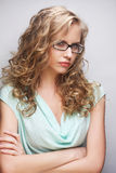 Friendly blond woman with glasses Royalty Free Stock Photos