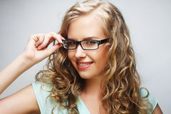 Friendly blond woman with glasses Stock Image