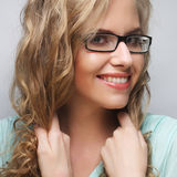Friendly blond woman with glasses Stock Photos