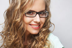 Friendly blond woman with glasses Stock Photo