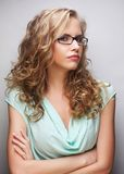 Friendly blond woman with glasses Royalty Free Stock Photography