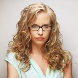 Friendly blond woman with glasses Royalty Free Stock Photo