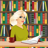 Friendly blonde student girl studying in library Stock Photo