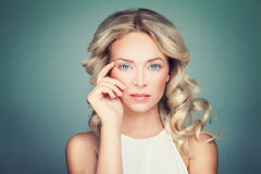 Friendly Blonde Woman Fashion Model with Curly Hair Royalty Free Stock Photo
