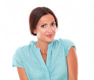Friendly brunette looking at you smiling Stock Photography