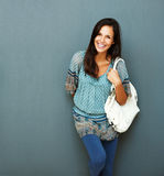 Friendly brunette with purse on her shoulder Royalty Free Stock Photography