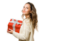 Friendly  brunette with red gift box Royalty Free Stock Images