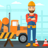 Friendly builder with arms crossed. Royalty Free Stock Photos