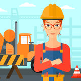 Friendly builder with arms crossed. Royalty Free Stock Images
