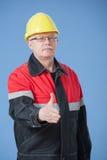 Friendly builder offering handshake Stock Images