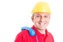 Friendly builder waiting for call Royalty Free Stock Image