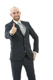 Friendly business man giving thumbs up Royalty Free Stock Photography