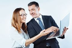Friendly business people enjoying working together stock photos