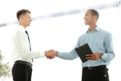 Friendly business people shaking hands on blurred background stock photo