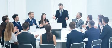 Friendly business team applause greeted his boss before the busi Stock Photography