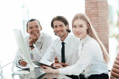 Friendly business team discussing promising business ideas. stock photography