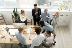 Diverse business team eating pizza together in office, top view royalty free stock photo