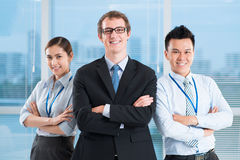 Friendly business team. Portrait of a modern business team smiling and looking at camera Stock Photo