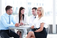 Business team sitting at a table in a cafe, on a work break Royalty Free Stock Photography